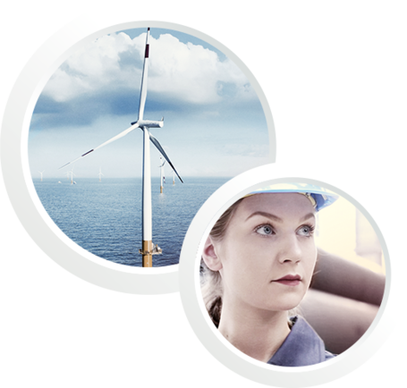 Two pictures in one: A windmill and an employee with helmet