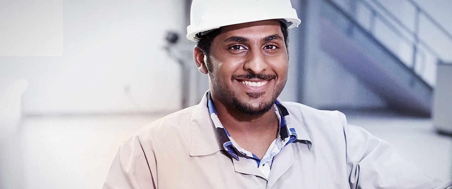 Smiling employee with workwear