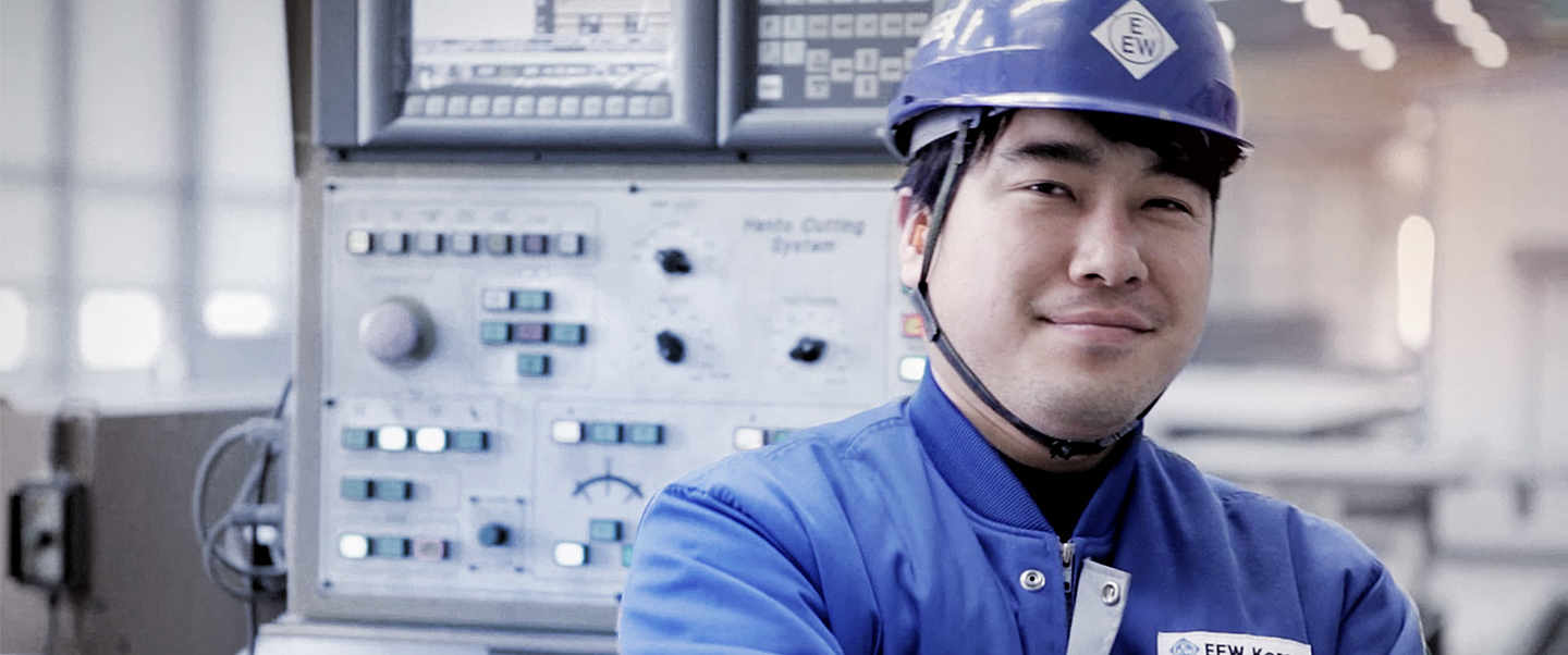 Smiling employee with helmet