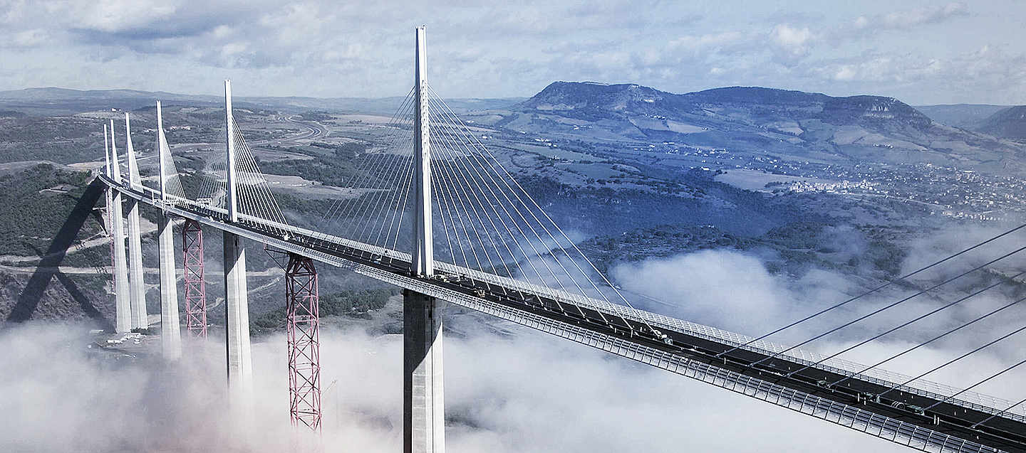 A big bridge for cars held by steel cables