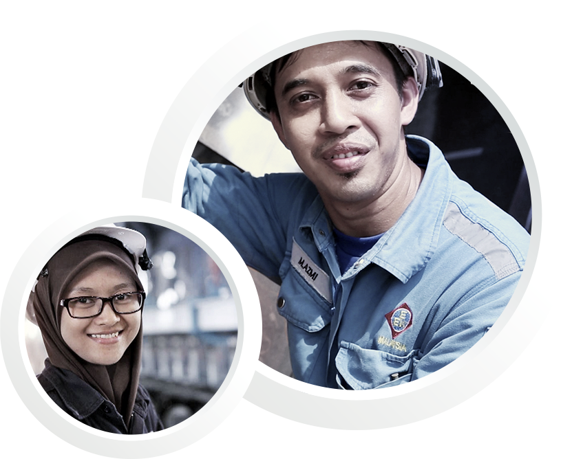 A male and a female malaysian employee with helmets and EEW branded workwear