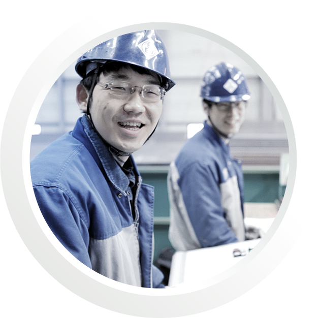 Smiling korean employees with EEW branded workwear